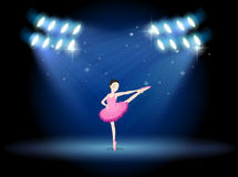 A girl dancing ballet at the stage with spotlights Royalty Free Stock Images