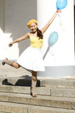 Girl dancing with baloon Royalty Free Stock Images