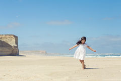 Girl dancing on the beach Royalty Free Stock Image