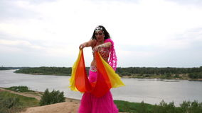 Girl dancing belly dance with a shawl stock video footage