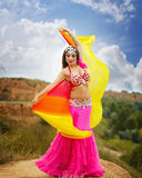Girl dancing belly dance with a shawl. Oriental Beauty belly dance. Nice girl in national dress dancing with shawl outdoors. Nomads Stock Image