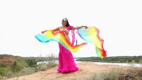 Girl dancing belly dance with a shawl stock video
