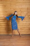Girl dancing in blue dress Stock Photography