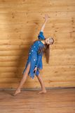 Girl dancing in blue dress Stock Image