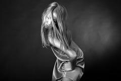 Girl dancing BW. Girl dancing, sensual girl dancing slow on black background, Black and white image royalty free stock photo