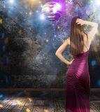 Girl dancing in a disco pub Royalty Free Stock Photos