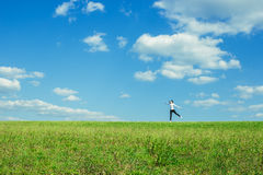 Girl dancing in the field summer time Stock Images