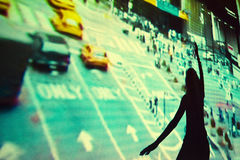 Girl dancing in front of video projection Stock Image