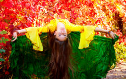 Girl dancing gypsy dance against the backdrop of autumn leaves Royalty Free Stock Photography