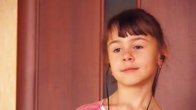 Girl dancing with headphones. stock video footage