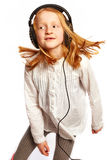Girl dancing with headphones Stock Photos