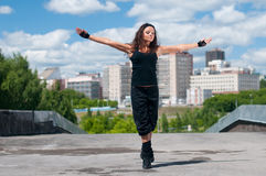 Girl dancing hip-hop over urban landscape Royalty Free Stock Image