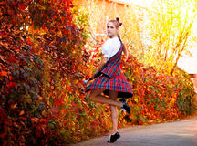 Girl dancing in the Irish dance costume Stock Photos