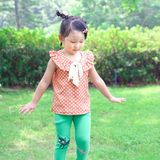 Girl dancing on the lawn Royalty Free Stock Images