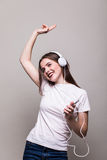 Girl dancing and listening to the music Stock Image