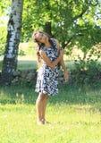Girl dancing on meadow Stock Photos