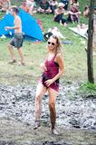 Girl dancing in the mud on Ozora Festival Stock Photography