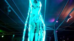 Girl dancing in neon lights
