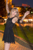 Girl is dancing at night Stock Photo