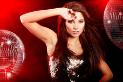 Girl dancing over mirror ball background Stock Photography