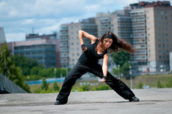 Girl dancing over urban city royalty free stock photography