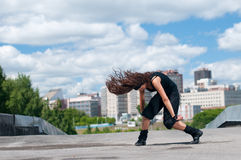 Girl dancing over urban landscape Royalty Free Stock Images
