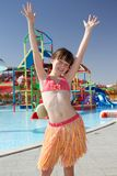Girl dancing by pool Stock Images