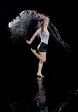 Girl dancing rain black background stock images