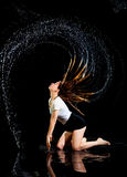Girl dancing rain black background stock photos