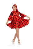 Girl dancing in a red polka-dot dress. Isolate on white Royalty Free Stock Photo