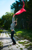 Girl is dancing with red scarf Royalty Free Stock Images