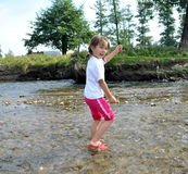 Girl dancing in the river Royalty Free Stock Photo