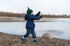 Girl dancing on a river bank Stock Photography