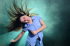 Girl dancing in smoke Stock Photos