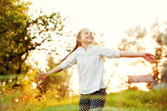 Girl dancing in the sunlight Stock Photo