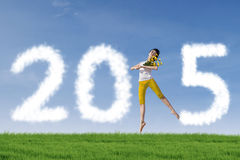 Girl dancing to celebrate new year outdoors Stock Images