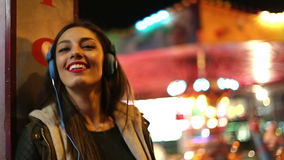 Girl dancing to the rhythm of music with headphones stock footage