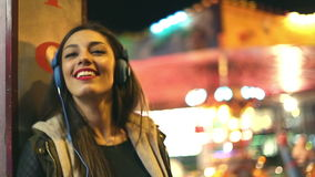 Girl dancing to the rhythm of music with headphones stock video