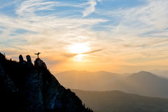 Girl dancing on top of the mountain Stock Image