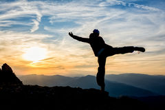 Girl dancing on top of the mountain royalty free stock photos