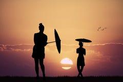 Girl dancing with umbrella Stock Photo