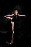 Girl dancing water ballet black background stock images