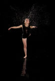 Girl dancing water ballet black background stock photo