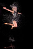 Girl dancing water jumping black background stock photo
