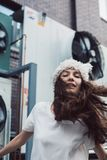 Girl dancing in white dress and fur hat Royalty Free Stock Photos