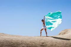 Girl dancing in the wind. With a cloth royalty free stock images