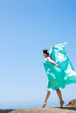 Girl dancing in the wind. With a cloth royalty free stock photography