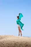 Girl dancing in the wind. With a cloth stock image