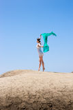 Girl dancing in the wind. With a cloth royalty free stock photos