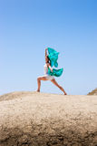 Girl dancing in the wind. With a cloth Royalty Free Stock Image